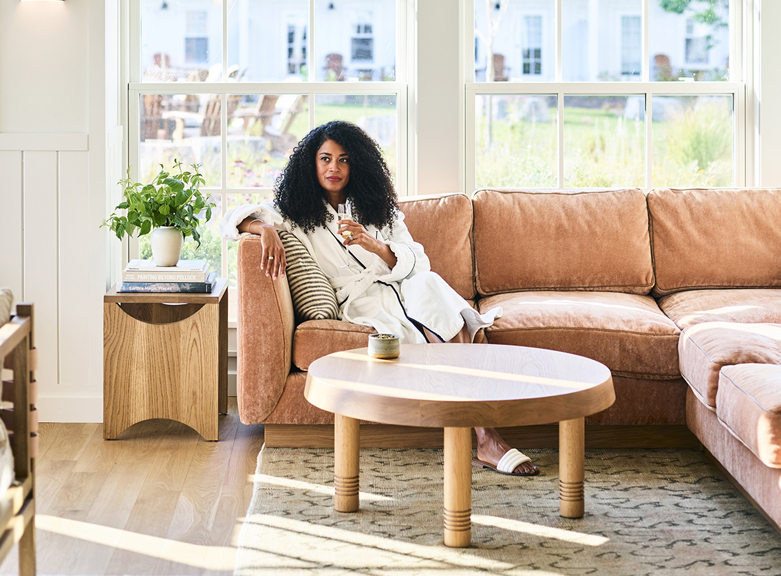 Woman lounging on couch in sun room